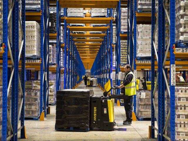 Warehouse logistics workers distributing goods